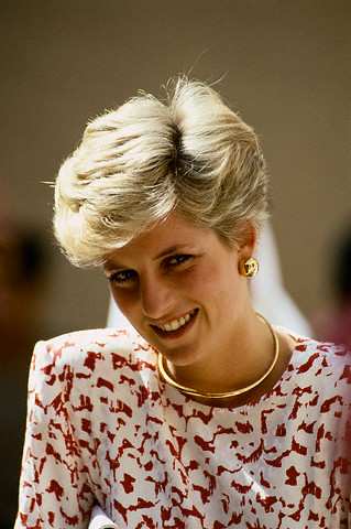 Princess Diana wears gold jewelry with her short haircut.